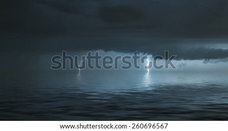 lightning bolts reflection over the sea - stock photo
