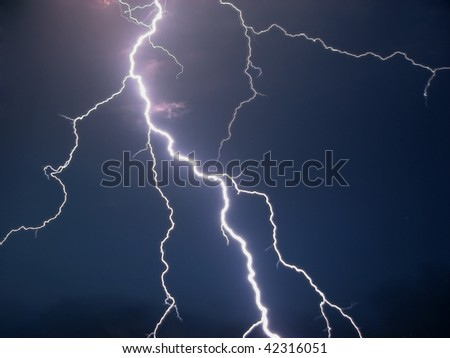 Lightning in a dark night - stock photo