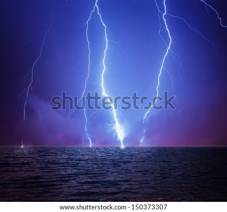 Lightning in a stormy sky - stock photo