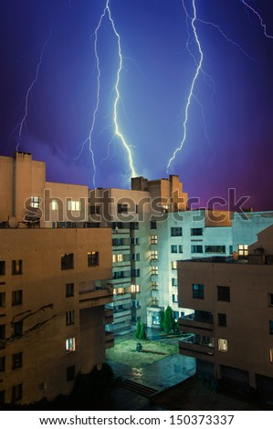 Lightning in the sky above the dwelling house - stock photo