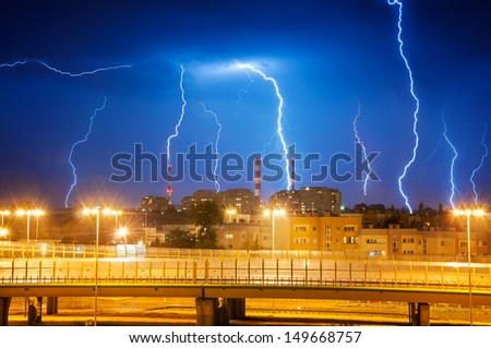 Lightning in the sky over the city - stock photo