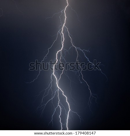 Lightning in the sky strikeing down - stock photo