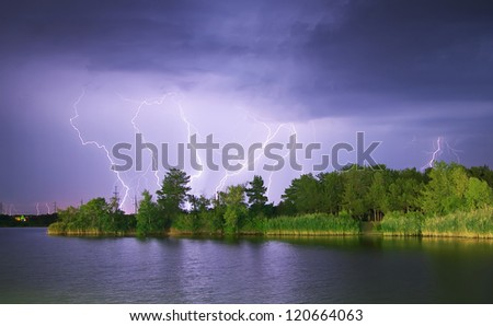 Lightning on the river. Nature composition. - stock photo