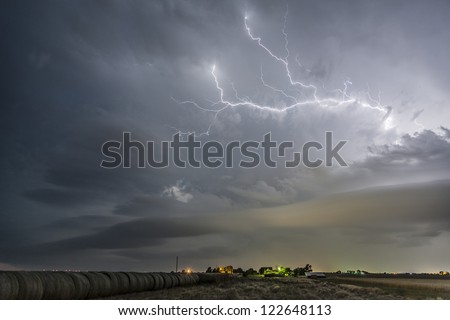 lightning over hay bales - stock photo