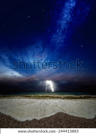 Lightning over sea, dark stormy sky, stormy sea, bright galaxy and stars in dark blue sky. Elements of this image furnished by NASA nasa.gov - stock photo