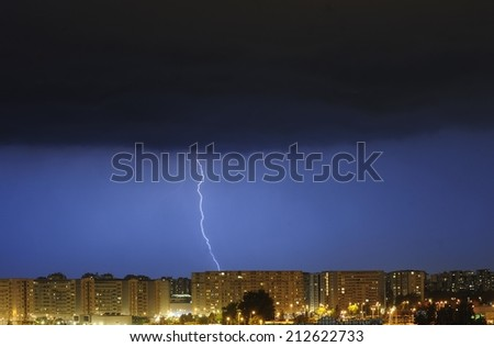 Lightning over  town - stock photo
