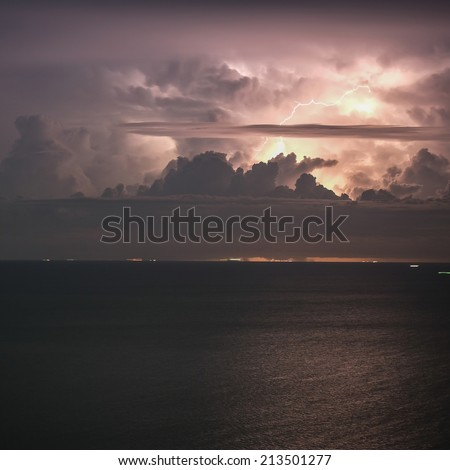Lightning storm at sea - stock photo