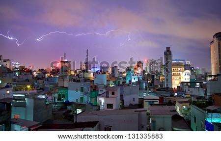 Lightning storm over city of Saigon - stock photo
