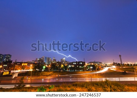 Lightning strike above the Denver Colorado skyline - stock photo