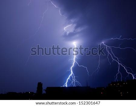 lightning strike in the city - stock photo