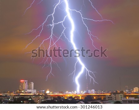 Lightning strike in the night rain - stock photo