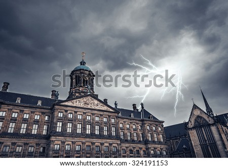 Lightning strike on a cloudy sky over the ancient building. Toned photo. - stock photo