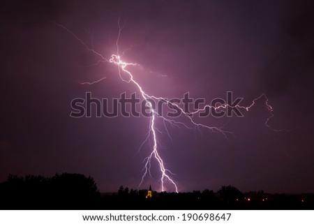 Lightning strikes from the evening sky - stock photo