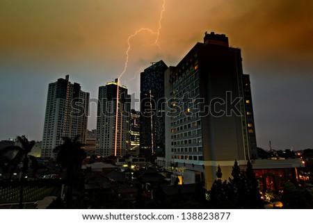 lightning strikes tall highrise building - stock photo
