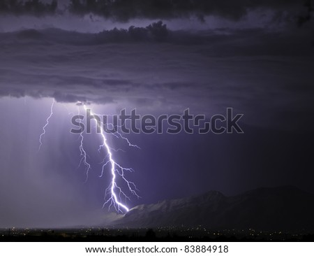 Lightning striking the Catalinas - stock photo