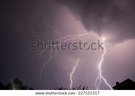 lightning under the city  - stock photo