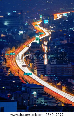 "Lights from vehicles headlight and taillight creating ""light trail"" - stock photo"