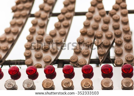 Lights of a sign in an amusement park - stock photo