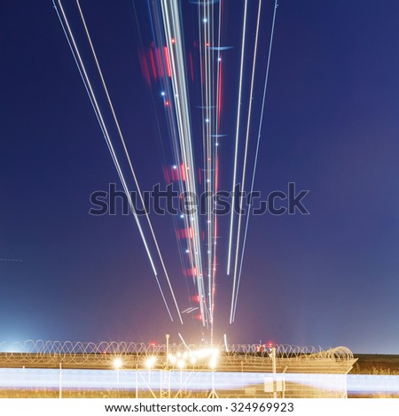 lights of aircraft on the glide path during night landings - stock photo