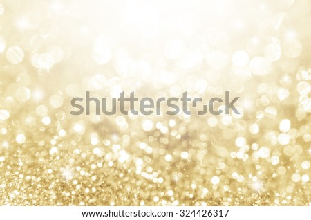 Lights on gold with star bokeh abstract as background. - stock photo