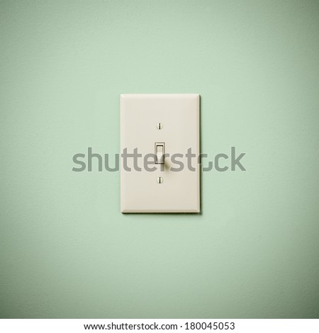 Lightswitch on Blue Green Aqua Teal  Wall Off - stock photo