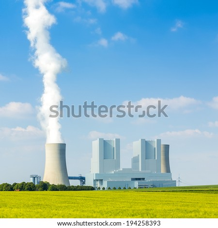 lignite-fired power plant with cooling tower in summer - stock photo