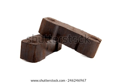 lignite, two bricks of coal, white background, isolated,  - stock photo