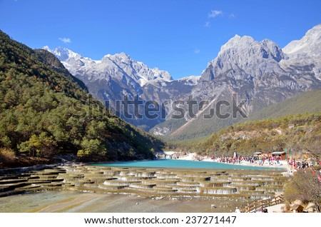 LIJIANG, CHINA - NOVEMBER 28, 2014: Blue Moon Valley is in Yulong snow mountain scenic area. There are artificially made natures in this area. - stock photo