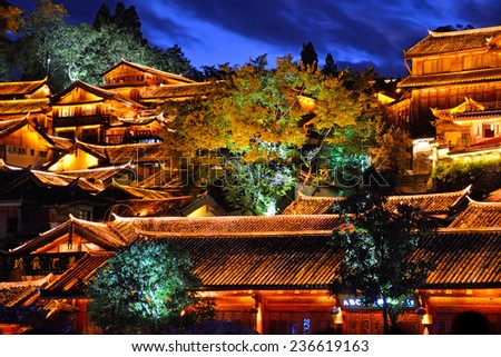 LIJIANG, CHINA � NOVEMBER 28, 2014: Old Town of Lijiang has a history going back to the thirteenth century and was a confluence for trade along the old tea horse road.It located 2400 meters high. - stock photo