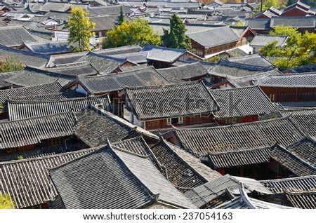 LIJIANG, CHINA - NOVEMBER 26, 2014: Old Town of Lijiang has a history going back to the thirteenth century and was a confluence for trade along the old tea horse road.It located 2400 meters high. - stock photo