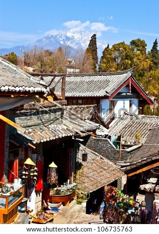 Lijiang Dayan Old Town. The town be listed at the World Heritage Site in 1997. In the town, you can see Jade Dragon Snow Mountain. - stock photo