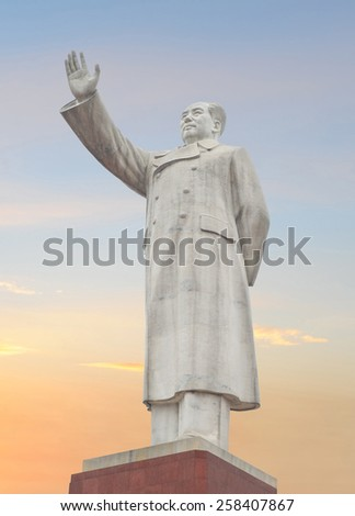 LIJIANG - MAY 8: famous monument of chairman Mao Zedong on 8 May 2013 in Lijiang, China. The monument has been erected to honor Mao who lead the war against the Japanese and Kuomingtang nationalists. - stock photo