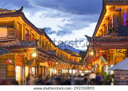Lijiang old town in the evening with crowed tourist. - stock photo