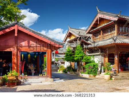 LIJIANG, YUNNAN PROVINCE, CHINA - OCTOBER 23, 2015: Scenic view of wooden traditional Chinese houses in the Old Town of Lijiang. The Old Town of Lijiang is a popular tourist destination of Asia. - stock photo