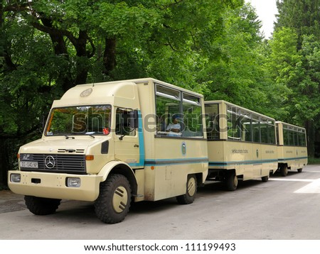 LIKA-SENJ, CROATIA-MAY 21:Bus tour is ready to start at Plitvice National Park on May 21,2012 in Lika-Senj. Bus tours run regularly everyday. This bus is specially designed for touring in a forest. - stock photo