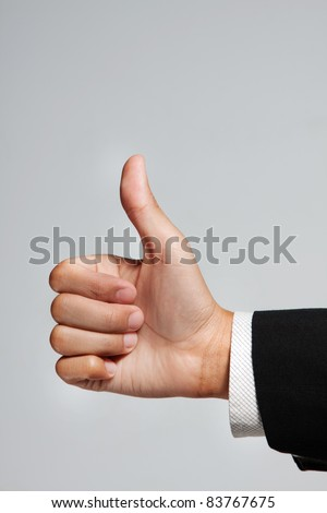Like. Thump up hand of business man - stock photo