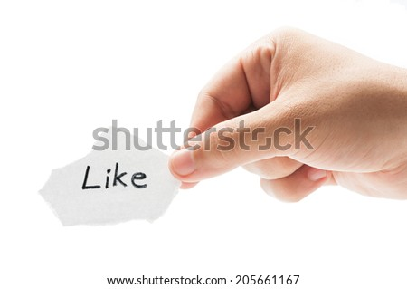 Like us on facebook concept using a hand holding a piece of paper and the text written by hand with a permanent marker - stock photo