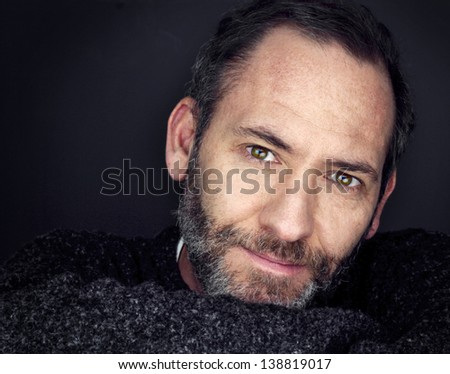 likeble man smiles into camera - stock photo