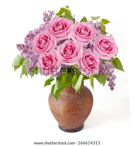Lilac and roses bunch in vase isolated on white background - stock photo