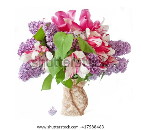 Lilac and tulips bunch in vase isolated on white background - stock photo