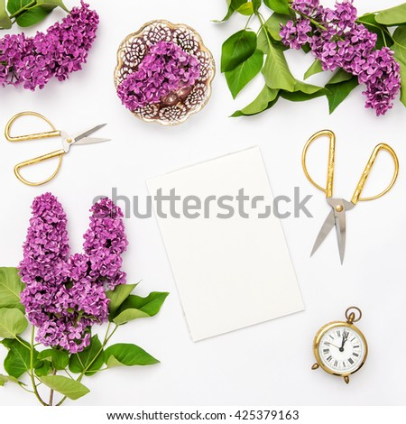 Lilac flowers, notebook, golden accessories. Flat lay sketchbook, top view - stock photo