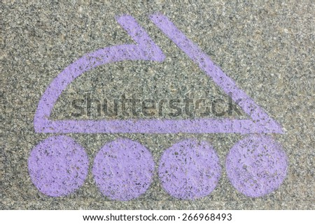 Lilac logo in the form of a roller skate on the granite floor - stock photo