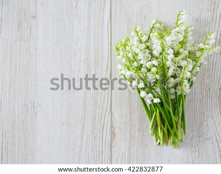 lilies of the valley on the wooden surface - stock photo