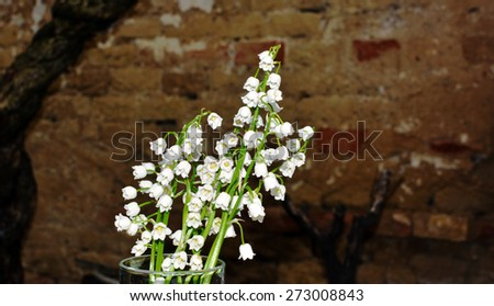 Lilies on the grunge background - stock photo