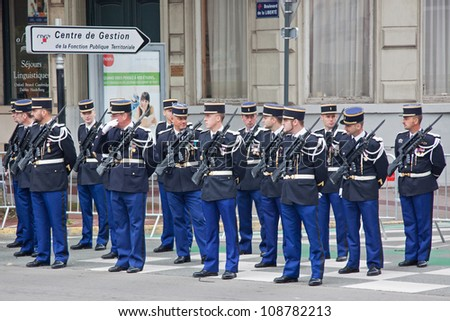 LILLE, FRANCE - JULY 14: A Gendarmerie unit lines up ready for a Bastille Day march in Lille, France on July 14, 2012. All members of the armed and civil defence forces are represented in such parades - stock photo