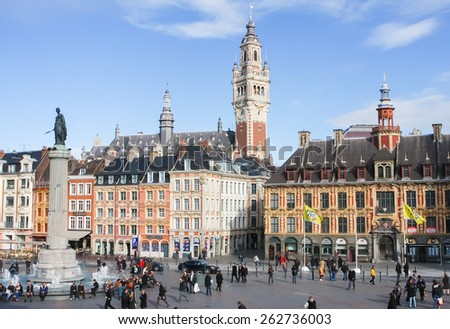 LILLE, FRANCE - NOVEMBER 2, 2009: Chambre of Commerce and Statue and Column of Deesse (1845) at the Place General de Gaulle in Lille, France. - stock photo