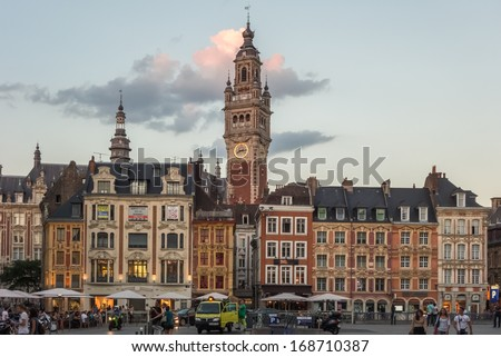 LILLE, FRANCE - SEPTEMBER 5: View over the lively Place du General de Gaulle to the Belfry being one of the town's landmark at sunset. September 5th, 2013 in Lille, France - stock photo