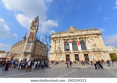 LILLE - SEPTEMBER 13: Famous belfry tower of Chamber of Commerce and Industry & Opera Lille buildings on September 13, 2014 in Lille, France - stock photo
