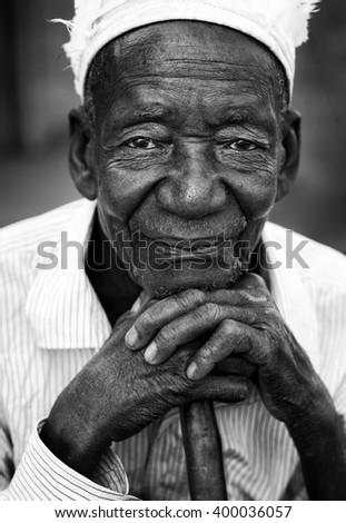 LILONGWE - MALAWI - JULY 25, 2015: Unidentified old Malawian man with hat on July 25, 2015 in a village near Lilongwe, Malawi - stock photo