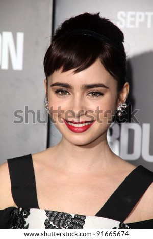 "Lily Collins at the ""Abduction"" World Premiere, Chinese Theater, Hollywood, CA. 09-15-11 - stock photo"